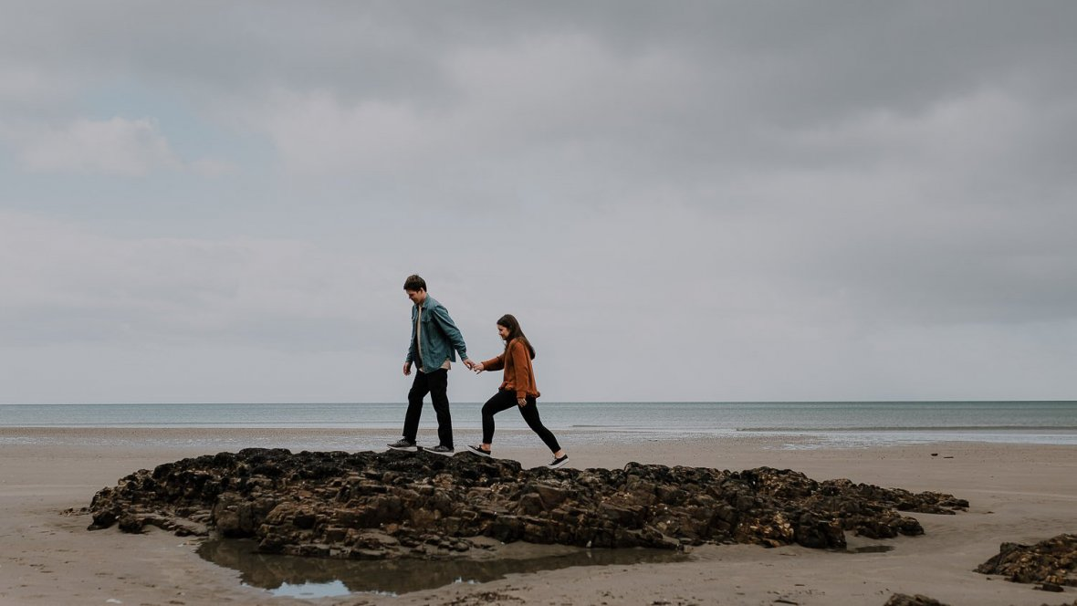Waihi Beach Couples Adventure Session Couple Walking at Beach